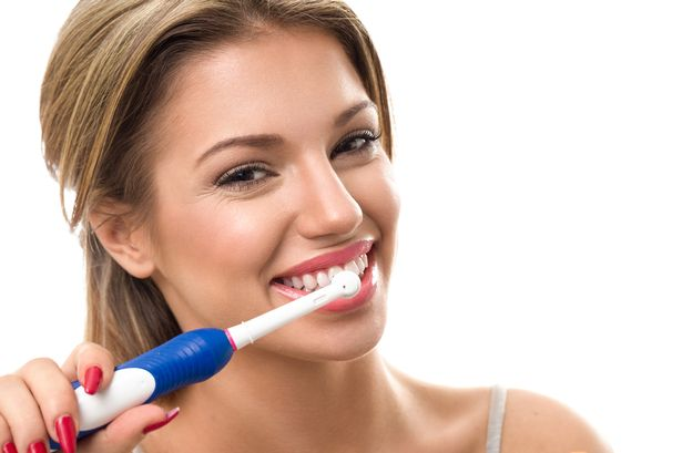 Young-beautiful-lady-brushing-her-healthy-teeth